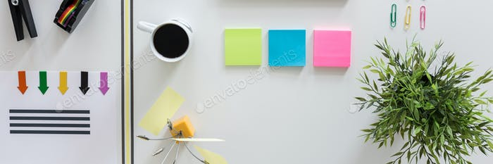 Office sticky notes, clips and coffee