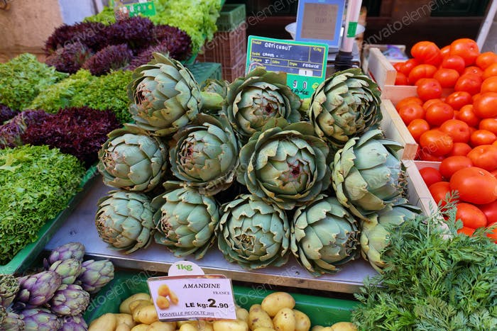 Artichokes and other vegetables in the market.