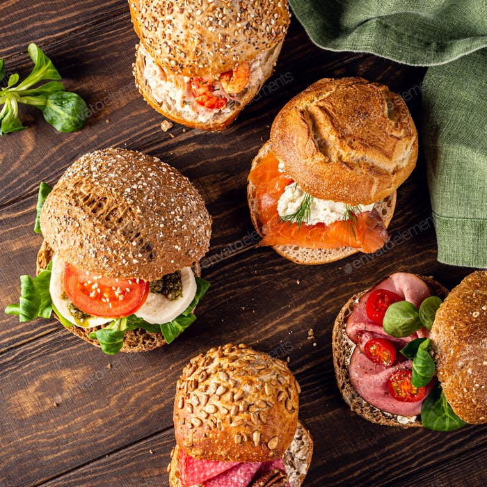 Assorted sandwiches on wooden table