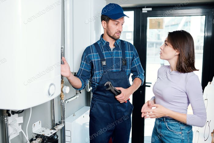 Young master of household maintenance service consulting one of clients