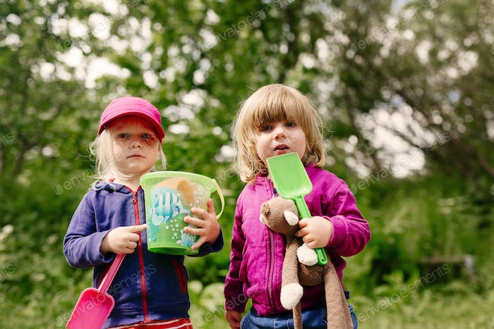 Portrait of girls with garden toys