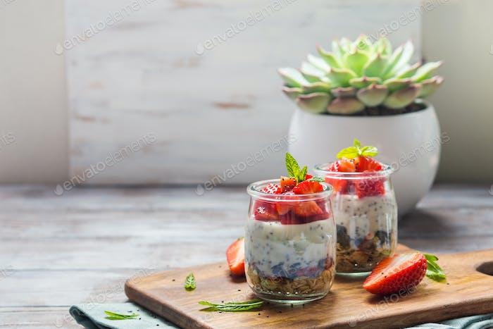 Yogurt and granola with strawberries. Breakfast