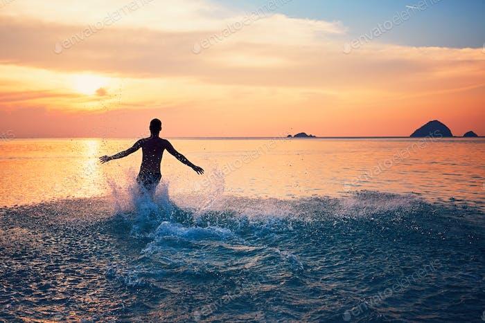 Man running into the sea