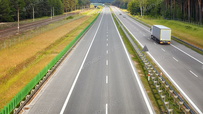 Panoramic picture of a lorry on almost empty highway