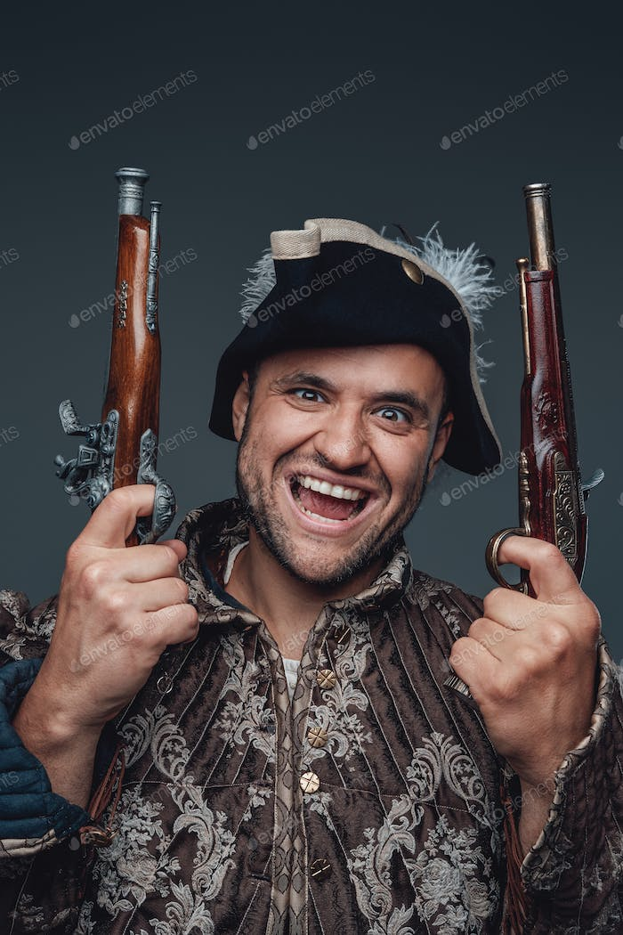 Portrait of crazy pirate with boarding pistols