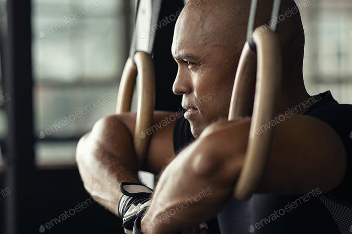 Determined man taking a break at gym