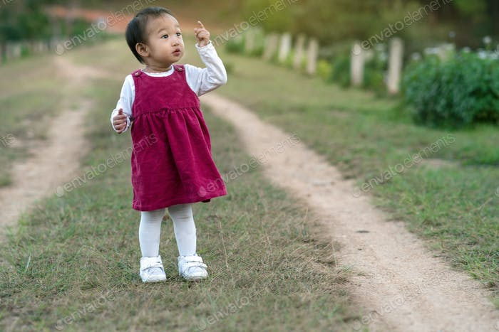Asian girl at the forest, Children and family concept