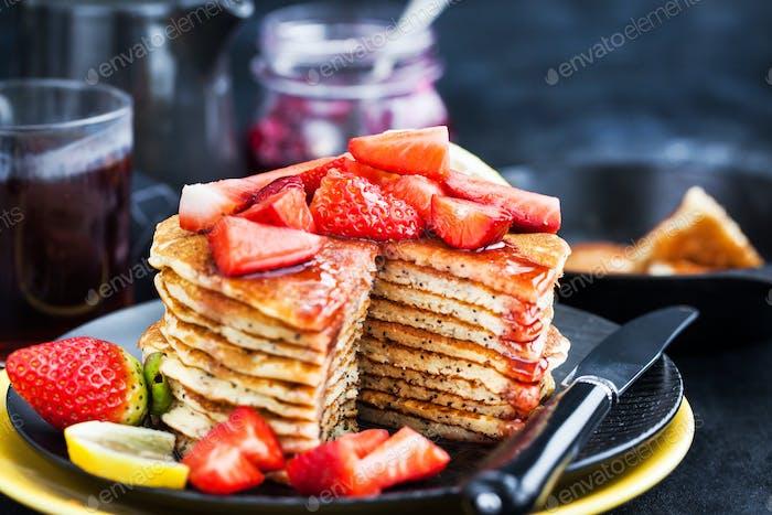 Stack of freshly prepared lemon poppy seed  pancakes with fresh