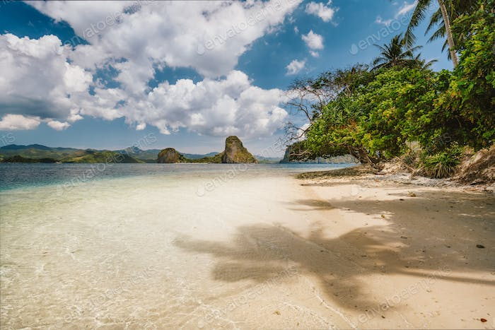 Vacation holiday season on Palawan island. Remote beach on island hopping tour. Ipil beach of