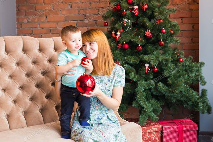 Mom with child playing at christmas evening, winter weekends, cozy scene