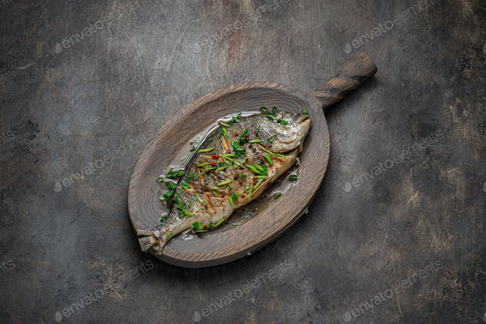 Fried whole fish asian style with oil and green onion, copy space