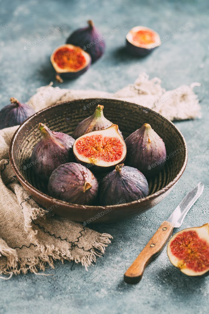 Ripe sweet figs and cut figs in a bowl.