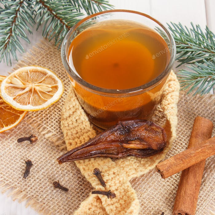 Spruce branches and cup of traditional compote of dried fruits for Christmas
