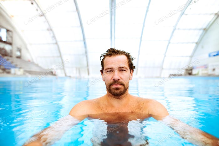 Man in the indoor swimming pool.