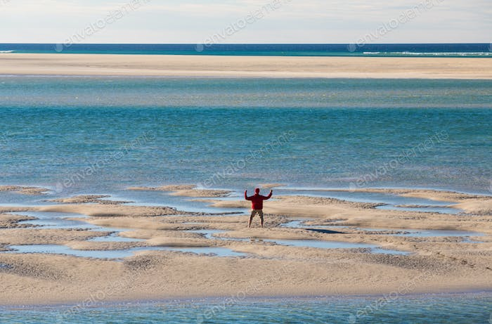 Man on Luskentyre Beach, view from above, arms outstretched