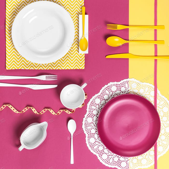 Serving dishes on a yellow pink background.