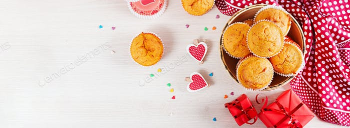 Muffins with pumpkin. Cupcakes with Valentine's Day decor. Flat