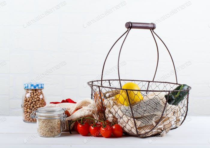 Fresh vegetables, fuits  and grains in textile bags and glass jars