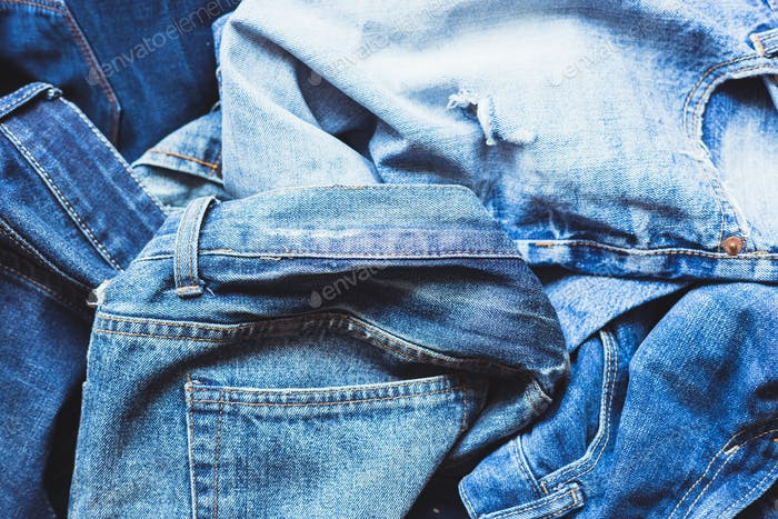 Jeans scattered on a wooden background