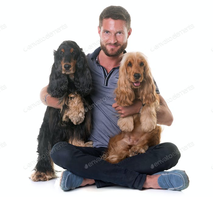 two cocker spaniel and man
