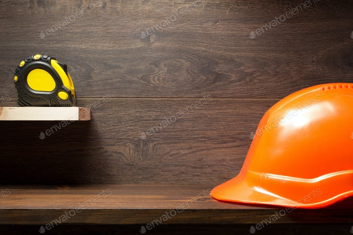 construction tools at wooden shelf