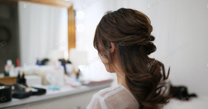 Woman having hair style in beauty salon