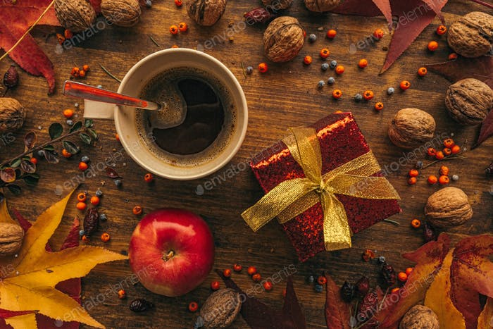 Autumn gift box with cup of coffee