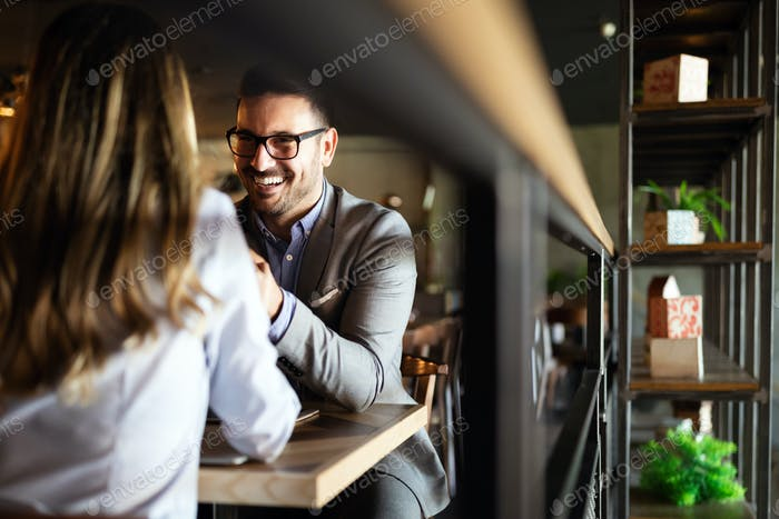 Attractive elegant young couple in love dating at the restaurant