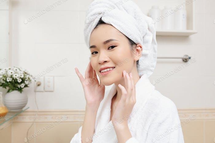 Woman touching her flawless skin