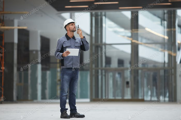 Construction Worker Holding Portable Radio