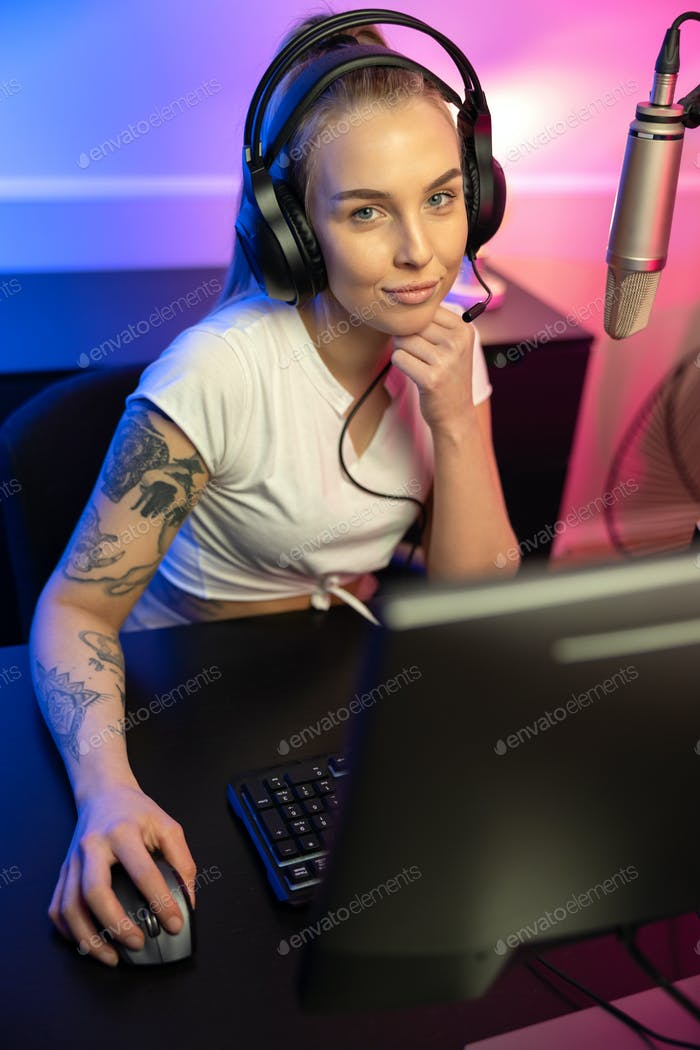 Professional esport gamer girl live streaming and plays online video game on PC