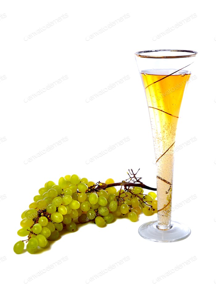 Wineglass with white wine and grape over white