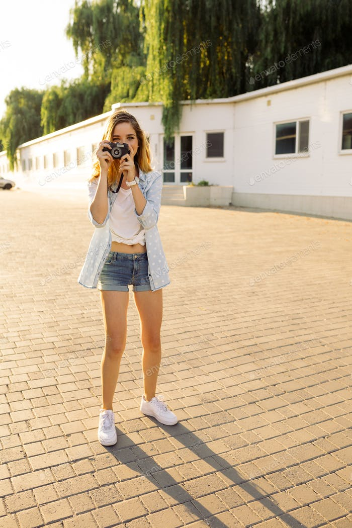 Hipster woman with retro film camera