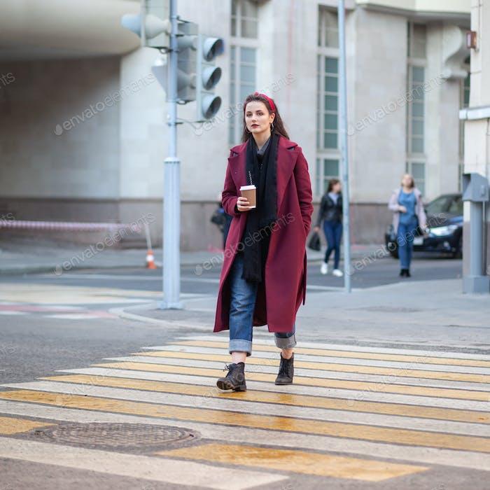brunette female on crosswalk in city