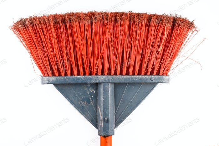 closeup of dirty sweeping broom on white background