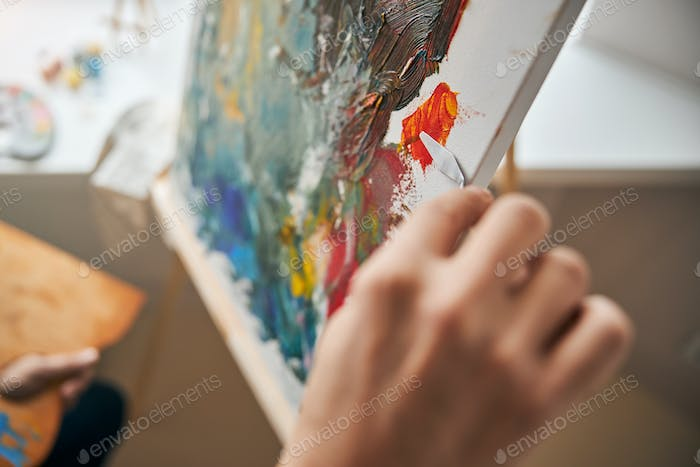 Hand of person working on a beautiful abstract picture
