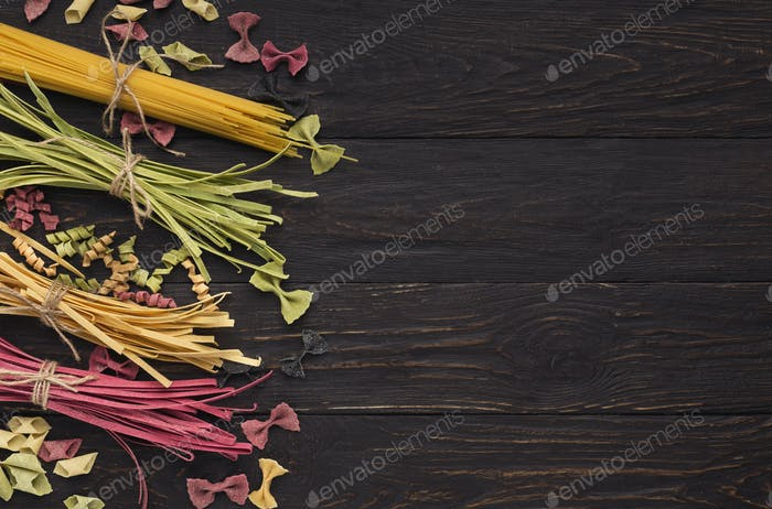 Various types of handmade pasta on black background