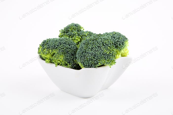 Fresh broccoli in a porcelain bowl