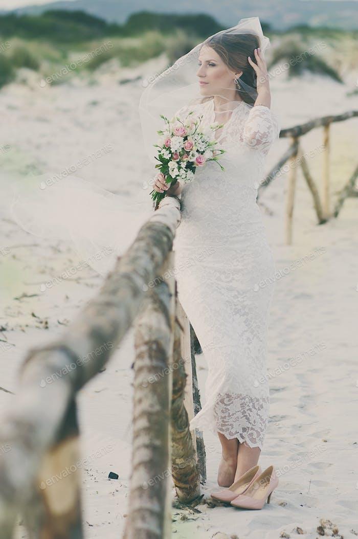 Beautiful happy young woman in wedding dress