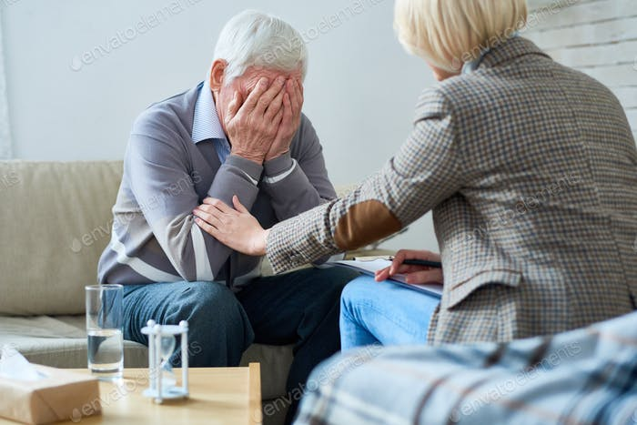 Therapist Comforting Senior Patient