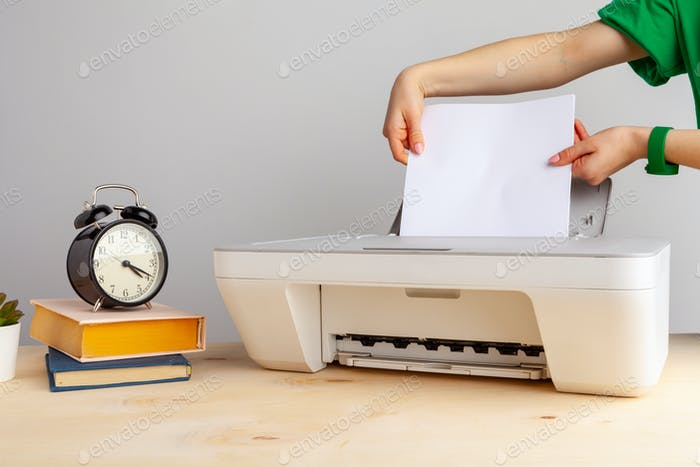 Close up of woman using a printer machine