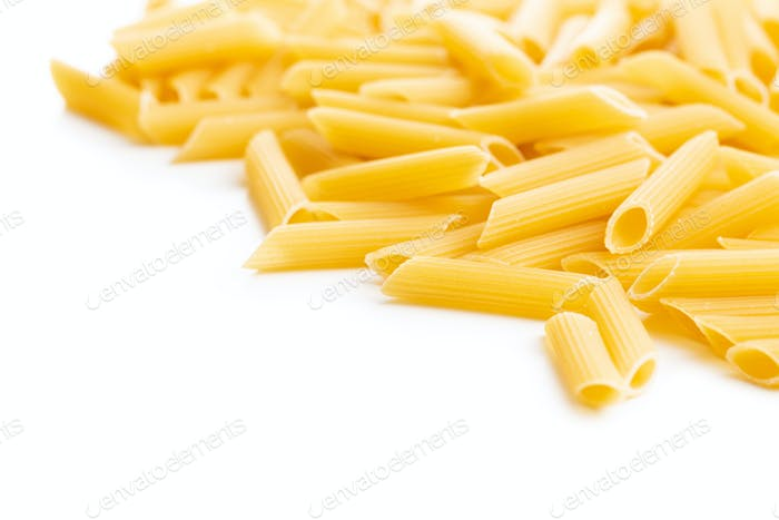 Uncooked penne pasta. Dried italian pasta