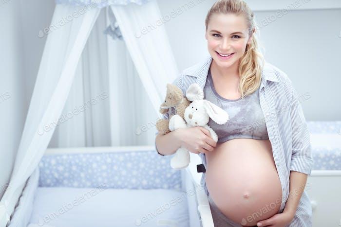 Cute pregnant woman at home