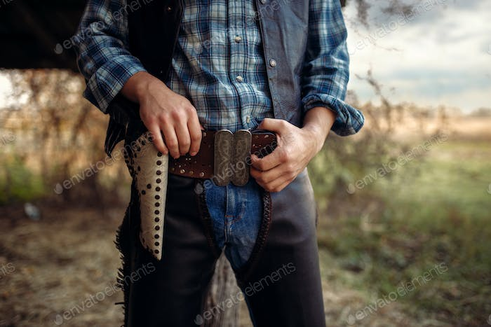 Cowboy with his hand on revolver, wild west