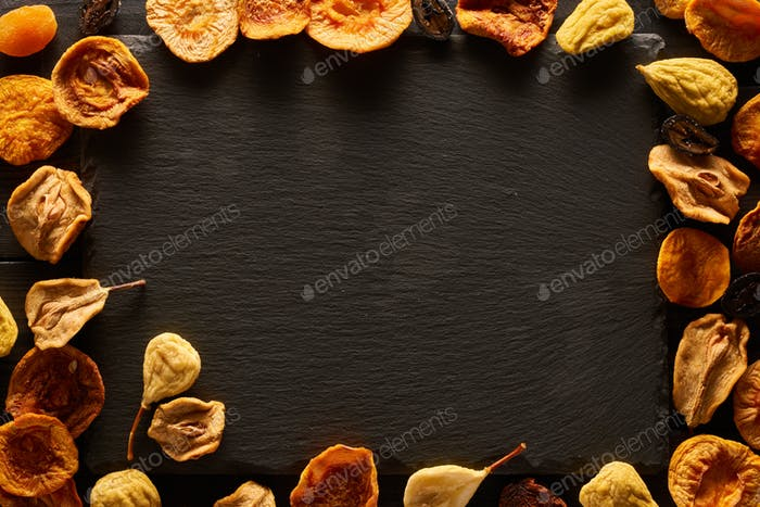Dried fruits on slate plate