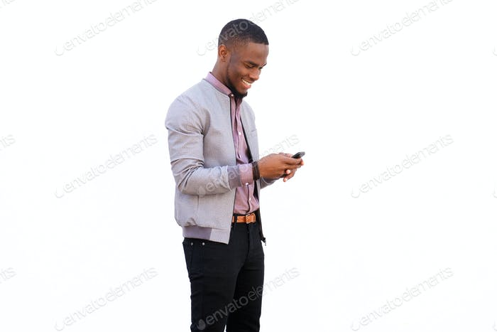Happy young african man reading text message