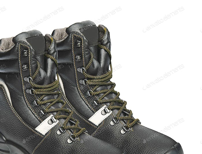 The high black leather boots isolated