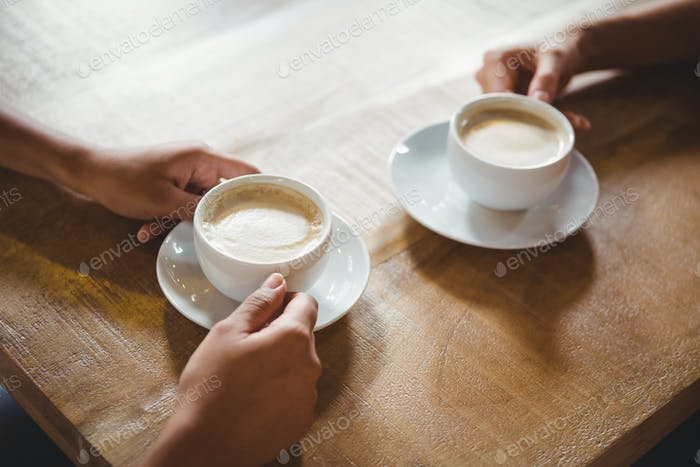 Close up of two cups of coffee on table