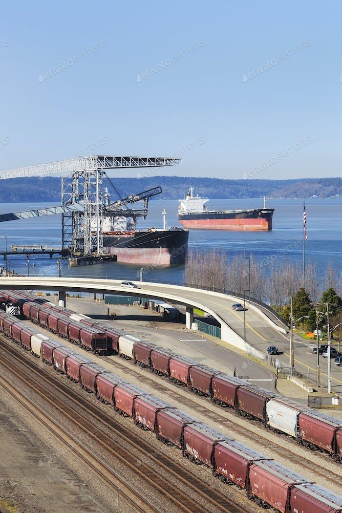 55286,Train yard near cranes in harbor