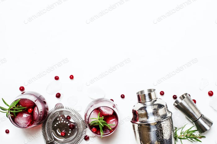 Cranberry cocktail with ice, rosemary